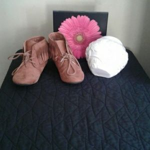 A pair of Midwest cowgirl boots  with ruffles